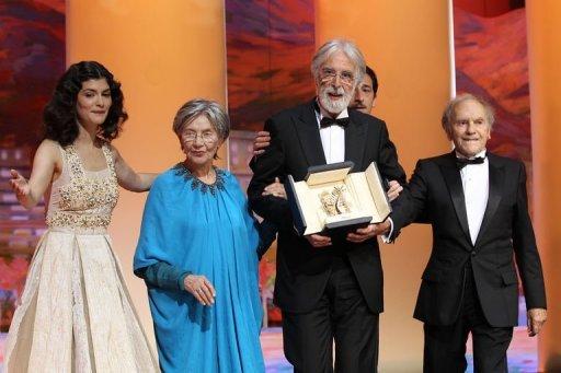 Michael Haneke, junto a sus dos actores principales de Amour